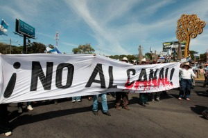 TIME: Demonstrators hold a banner during a march to protest against the construction of the Interoceanic Grand Canal in Managua