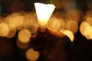 A-man-holds-a-candle-as-tens-of-thousands-of-people-attend-a-candlelight-vigil-at-Hong-Kongs-Victoria-park-Thursday-June-4-2009.-AP-PhotoVincent-Yu-960x634